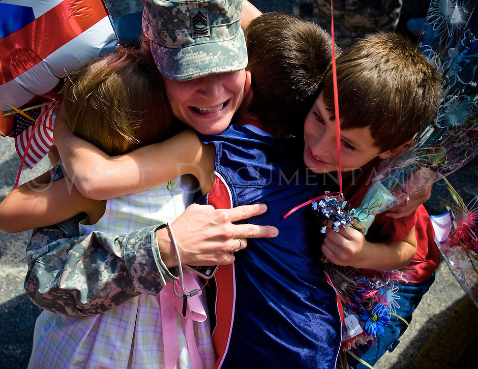 Master Sergeant Heather Pisciotti grabs her nieces and nephews at an homecoming event that was held at Moon High School in Moon, Pa., after returning from Iraq on a 18 month deployment with the 316 Expeditionary Sustainment Command on July 1, 2008.