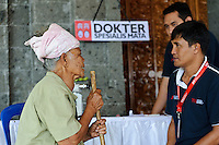 A woman consulting a doctor about problems with her sight, Bali, Indonesia.