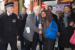 © Licensed to London News Pictures. 09/12/2014. London, UK. The Mayor of London, Boris Johnson and Metropolitan Police Commissioner Sir Bernard Hogan-Howe take part in a walkabout with local officers in Ealing town centre in West London today and announce details of the historic deal secured for the New Scotland Yard site in Victoria.. Photo credit : Vickie Flores/LNP