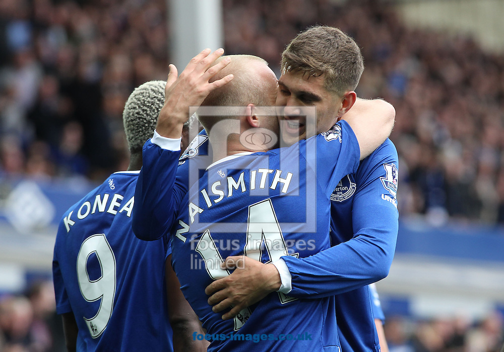 Steven Naismith of Everton celebrates with John Stones after scoring the first goal against Chelsea during the Barclays Premier League match at Goodison Park, Liverpool.<br /> Picture by Michael Sedgwick/Focus Images Ltd +44 7900 363072<br /> 12/09/2015