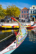 Traditional brightly painted gondola style moliceiro canal boat with scene painted on prow in Aveiro, Portugal