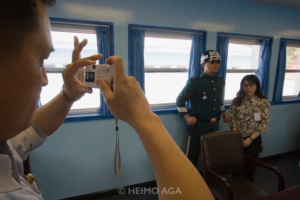 Panmunjom. Joint Security Area. Japanese tourists posing on the North Korean side of the barrack.
