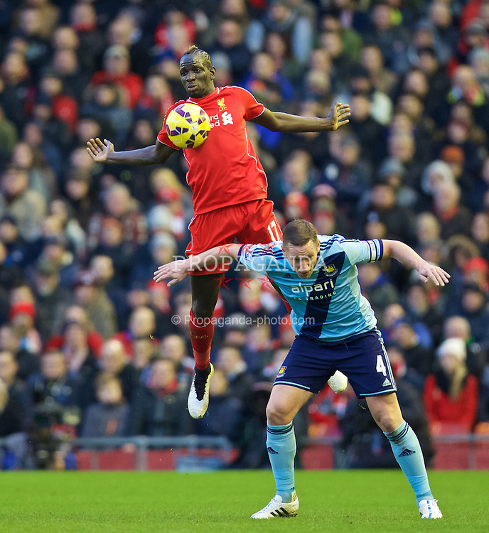 LIVERPOOL, ENGLAND - Saturday, January 31, 2015: Liverpool's Mamadou Sakho in action against West Ham United's captain Kevin Nolan during the Premier League match at Anfield. (Pic by David Rawcliffe/Propaganda)