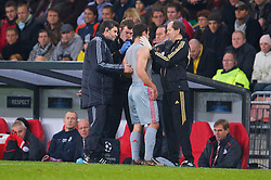 EINDHOVEN, THE NETHERLANDS - Tuesday, December 9, 2008: Liverpool's Javier Mascherano receives treatment from club Doctor Mark Waller during the final UEFA Champions League Group D match at the Philips Stadium. (Photo by David Rawcliffe/Propaganda)