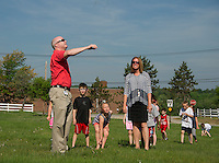 Gilford High School Tech Ed teacher Sean Walsh does a wind test with Patti Madore and her first grade students prior to setting off two Estes Rockets as part of Stem Day (science, technology, engineering and math)  on Wednesday morning at Gilford Elementary School.  (Karen Bobotas/for the Laconia Daily Sun)