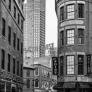 A black and white image of the streets of Boston featuring the Union Oyster House.