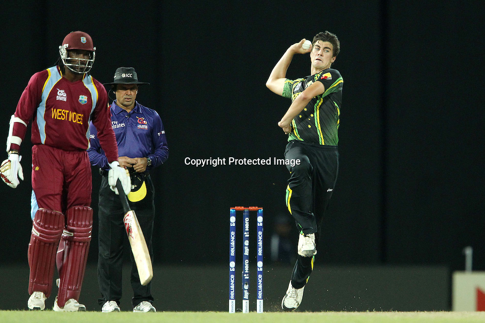 Pat Cummins bowls whilst Chris Gayle of The West Indies prepares to run during the ICC World Twenty20 semi final match between Australia and The West Indies held at the Premadasa Stadium in Colombo, Sri Lanka on the 5th October 2012<br /> <br /> Photo by Ron Gaunt/SPORTZPICS