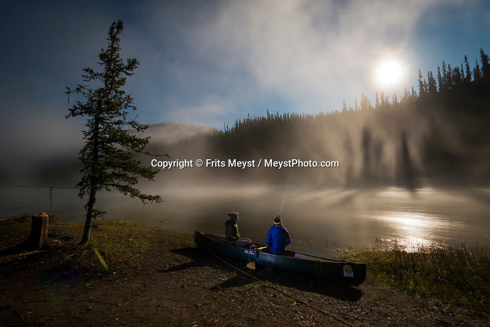 Yukon Territory, Canada, September 2014. Full moon plays with the autumn fog on the steaming Yukon river.  During this Yukon River canoe trip we paddled part of the Klondike Gold Rush route of 1898. We camped on the banks of the Yukon River in authentic northern wilderness and explored the gold rush relics on the way. Photo by Frits Meyst / MeystPhoto.com