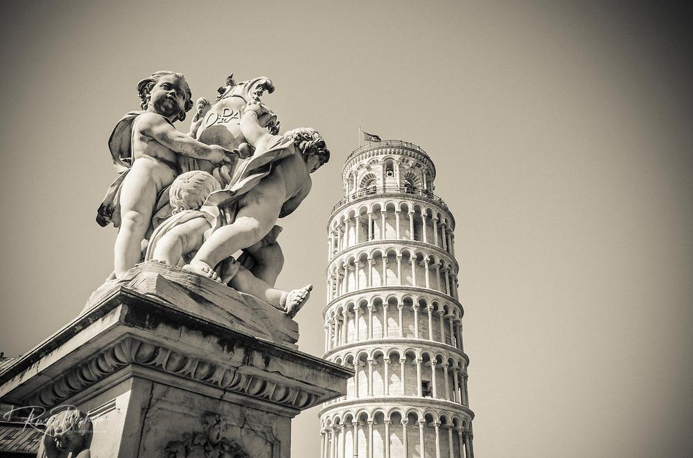 Cherub statue and the Leaning Tower of Pisa, Pisa, Tuscany, Italy