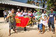 08 FEBRUARY 2014 - PHAWONG, SONGKHLA, THAILAND: Owners of a winning fighting bull pose with their bull at a bullfight in rural Songkhla province, Thailand. Bullfighting is a popular past time in southern Thailand. Hat Yai is the center of Thailand's bullfighting culture. In Thai bullfights, two bulls are placed in an arena and they fight, usually by head butting each other, until one runs away or time is called. Huge amounts of mony are wagered on Thai bullfights - sometimes as much as 2,000,000 Thai Baht ($65,000 US).   PHOTO BY JACK KURTZ