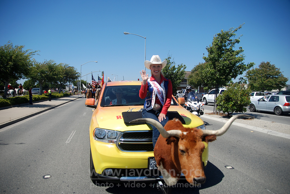 Tracy Hinson, Miss California Rodeo 2012, heads up the North Main Street mini-parade on Friday. The 102nd California Rodeo Salinas opened Thursday night, July 19 for a four-day run.