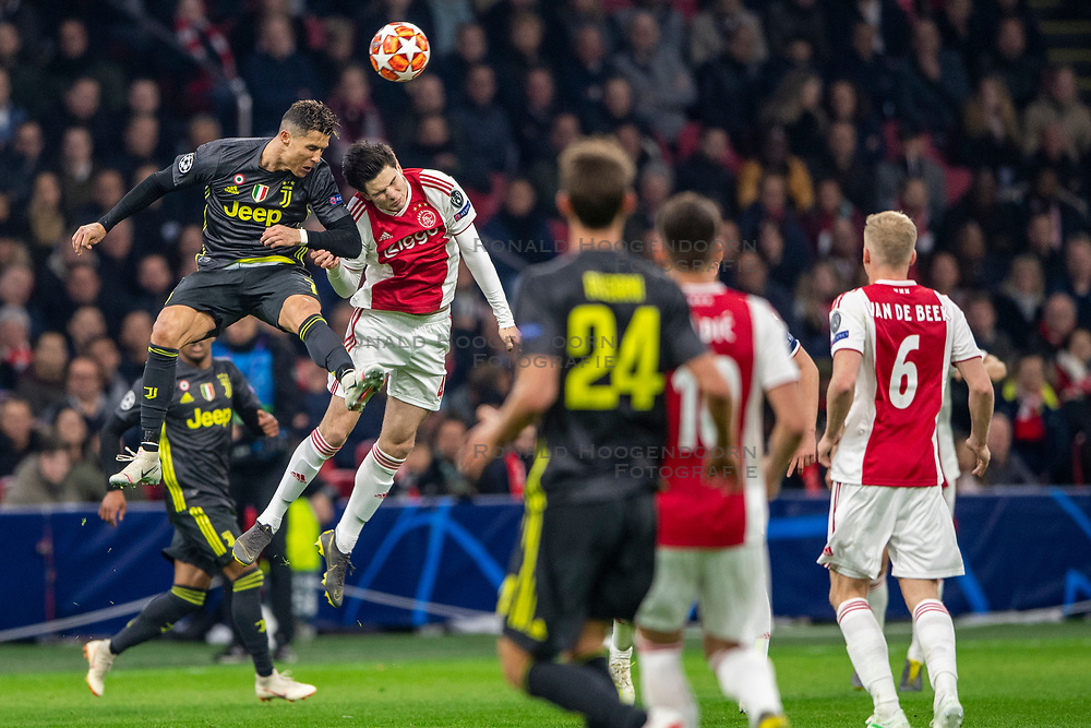 10-04-2019 NED: Champions League AFC Ajax - Juventus,  Amsterdam<br /> Round of 8, 1st leg / Ajax plays the first match 1-1 against Juventus during the UEFA Champions League first leg quarter-final football match / Jurgen Ekkelenkamp #40 of Ajax, Cristiano Ronaldo #7 of Juventus