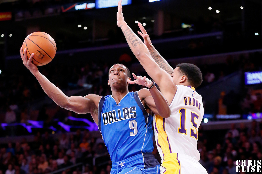 12 April 2014: Dallas Mavericks guard Rajon Rondo (9) goes for the layup against Los Angeles Lakers guard Jabari Brown (15) during the Dallas Mavericks 120-106 victory over the Los Angeles Lakers, at the Staples Center, Los Angeles, California, USA.