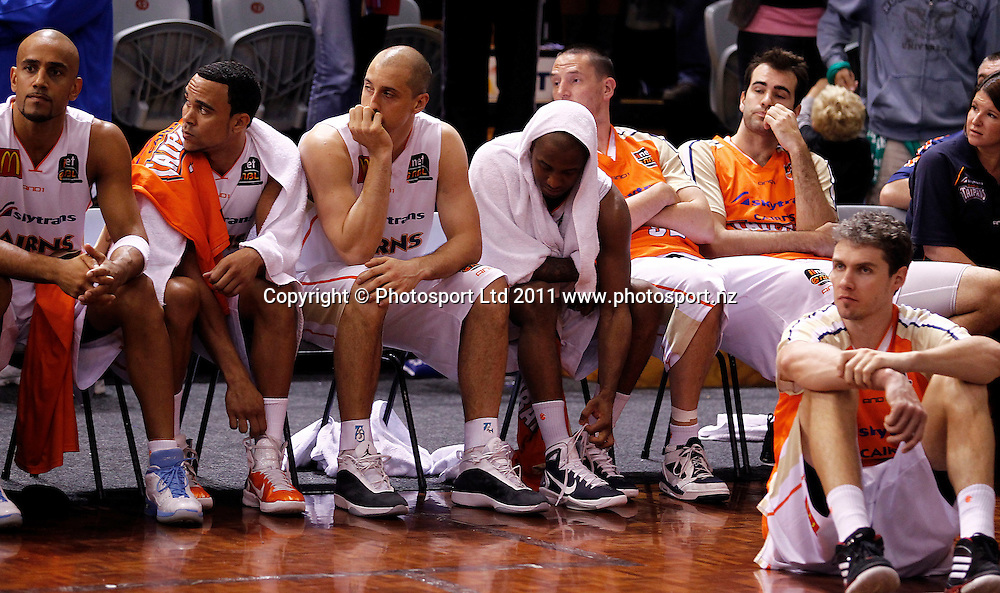 Dejected Taipans players after defeat to the Breakers during the ANBL Grand Finals Game 3, Burger King Breakers v Cairns Taipans at the North Shore Event Centre Auckland, New Zealand on Friday 29 April 2011. Photo: Simon Watts/photosport.co.nz