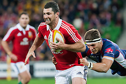 © Licensed to London News Pictures. 25/6/2013. Rob Kearney gets tackled during the British & irish Lions tour match between Melbourne Rebels Vs British & Irish Lions at AAMI Park, Melbourne, Australia. Photo credit : Asanka Brendon Ratnayake/LNP