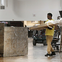 Adam Robison | BUY AT PHOTOS.DJOURNAL.COM<br /> Charles Fears, a temp worker, helps clean up empty boxes in Tupelo Furniture Market Building IV Friday morning in Tupelo.