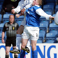 Queen of the South v St Johnstone...01.05.04  <br />Paul Bernard beats Wiilie Gibson to the ball<br /><br />Picture by Graeme Hart.<br />Copyright Perthshire Picture Agency<br />Tel: 01738 623350  Mobile: 07990 594431