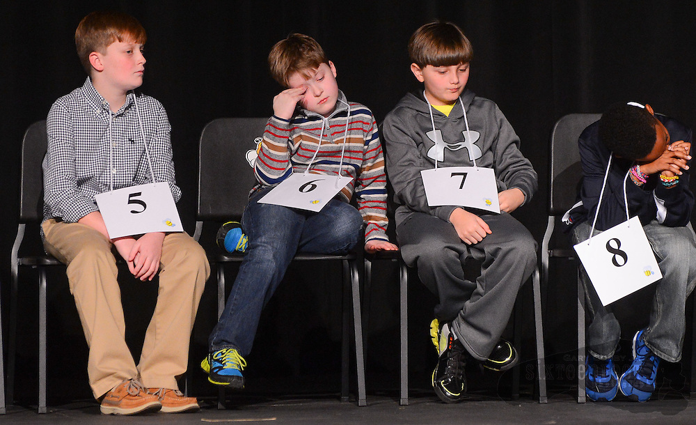 Gary Cosby Jr./Decatur Daily   Contestants Cameron Stephens, Garrett Britnell, Spencer Lott and Jalen Orr wait through a word challenge which caused a break in the spelling during the Morgan County Spelling Bee at Hartselle High School Thursday afternoon.