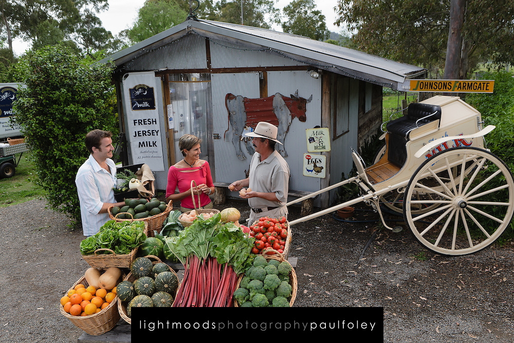 Couple shopping at Roadside Fruit and vegetable market, Clarencetown, NSW, Australia