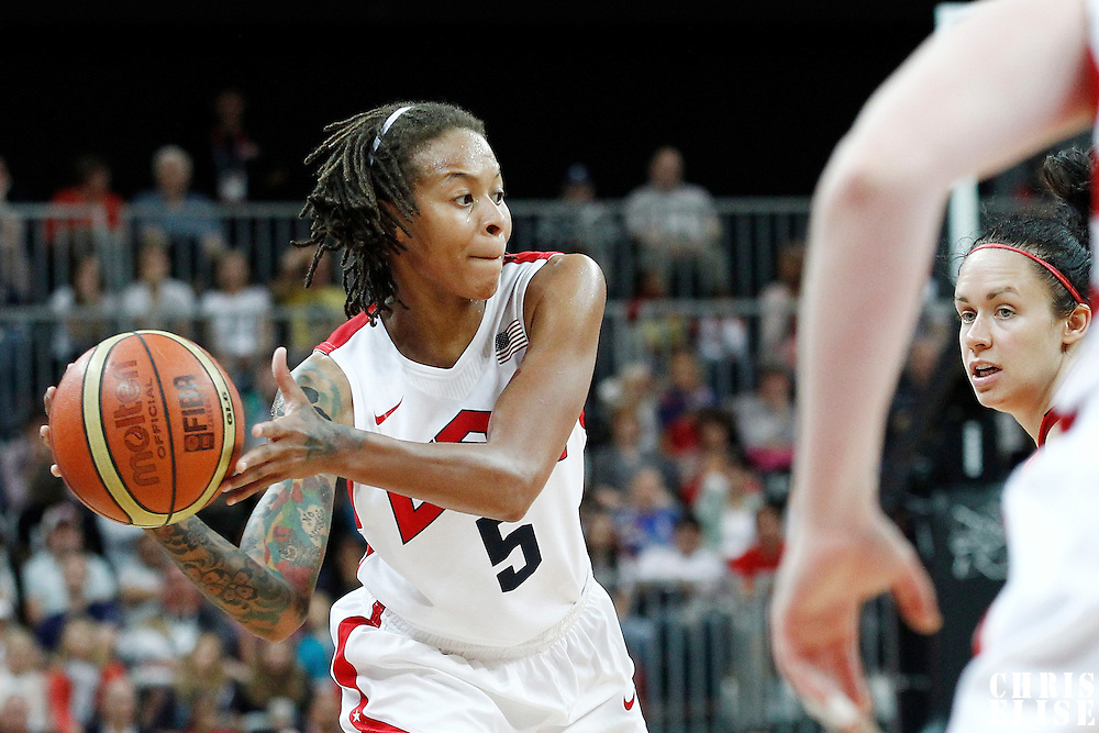 07 August 2012: USA Seimone Augustus looks to pass the ball during 91-48 Team USA victory over Team Canada, during the women's basketball quarter-finals, at the Basketball Arena, in London, Great Britain.