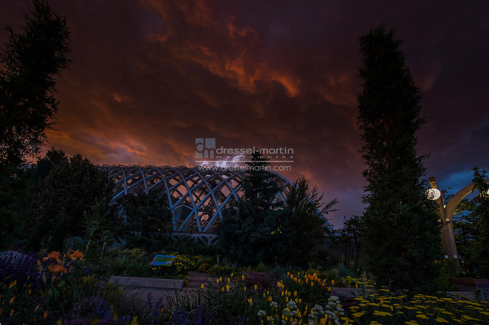 dramatic clouds over the conservatory