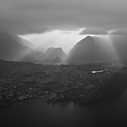 Aerial view of a village at the lake of thun. Mystic scenery.