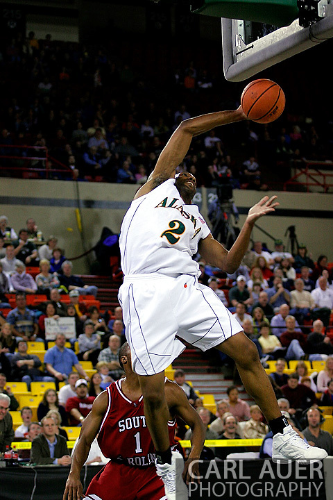 24 November 2005:  University of Alaska Anchorage senior forward Brian Hills attempts to score on a alley-oop pass in the first half of the UAA Seawolves 60-65 loss to the South Carolina Gamecock's in the first round of the Great Alaska Shootout at the Sullivan Arena in Anchorage Alaska.