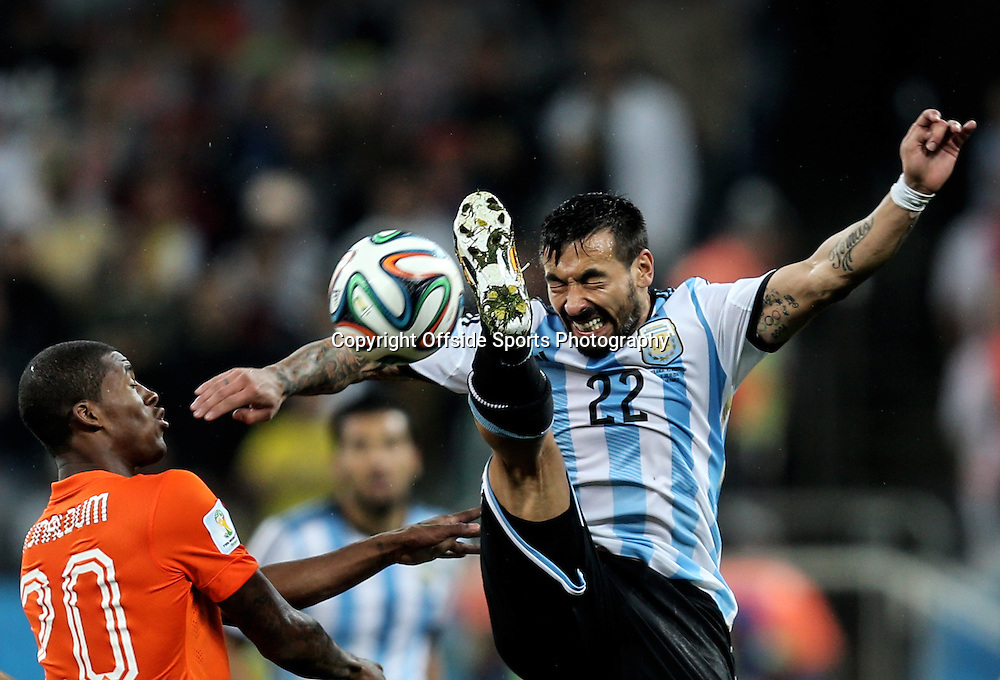 09 July 2014 - FIFA World Cup Brazil 2014 - Semi Final - Netherlands v Argentina - Ezequiel Lavezzi of Argentina in action with Georginio Wijnaldum of Netherlands - Photo: Marc Atkins / Offside.