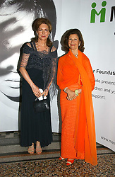 Left to right, HM QUEEN NOOR OF JORDAN and HM QUEEN SILVIA OF SWEDEN at a gala dinner in the presence of HM Quenn Silvia of Sweden and HM Queen Noor of Jordan in aid of the charity Mentor held at the Natural History Museum, Cromwell Road, London on 23rd May 2006.<br />