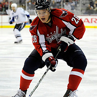26 December 2007:  Washington Capitals left wing Alexander Semin (28) skates to control a loose puck in the corner in the first period against the Tampa Bay Lightning at the Verizon Center in Washington, D.C.  The Capitals defeated the Lightning 3-2.