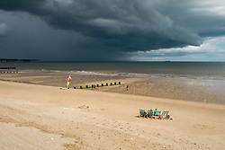 Families enjoying the sun and sand of Bridlington Holiday resort on North Beach West Yorkshire as a rain storm threatens<br />  4 August 2016<br />  Copyright Paul David Drabble<br />  www.pauldaviddrabble.photoshelter.com
