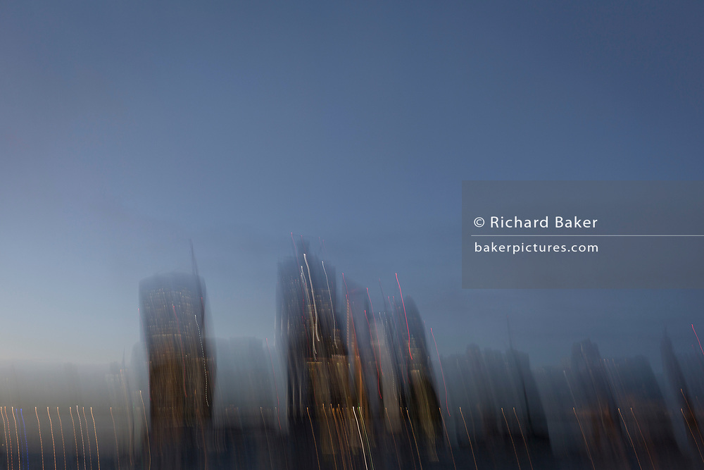 Blurred skyline of the City of London - the capital's financial district (aka The Square Mile), on 29th October 2018, in London, England.