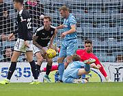 Young keeper Kyle Gourley keeps his eye on the ball as Kevin Holt gets a sore one - Dundee v Bolton Wanderers pre-seson friendly at Dens Park, Dundee, Photo: David Young<br /> <br />  - © David Young - www.davidyoungphoto.co.uk - email: davidyoungphoto@gmail.com