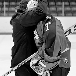 WHITBY, ON  - MAR 14,  2017: Ontario Junior Hockey League, playoff game between the Whitby Fury and Wellington Dukes. Whitby Fury Head Coach Scott McCrory and goaltender Connor Ryckman #1 of the Wellington Dukes share a moment after Wellington Dukes won game 7.<br /> (Photo by Shawn Muir / OJHL Images)