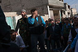 Soldiers mourn the death of five FSA members lying at the back of a pickup in their funeral with relatives and neighbours across Anadan. .Saturday morning eight members of the FSA and one civilian were killed by the result of an ambush made by mercenaries and security forces close to a checkpoint in the outskirts of Babis, North Aleppo. Anadan, North Syria, saturday, April 21, 2012...Ahmad Howari, 20..Abo Khattab Alsifrini, 19..Omar Mohamed Ali, 20..Mahmod Nakkar, 28..*In this town, 10 persons have been found dead,15 wounded and one missing in an attack were 18 tanks, 14 military cars and around 300 soldiers burned down 118 houses and 120 shops in a operation by the Syrian regime of Bashar-Al-Assad at April 13th and 14th activist says, Syria, April 21, 2012. Photo by Daniel Leal-Olivas / i-Images...