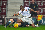 Uche Ikpeazu (#19) of Heart of Midlothian is brought down in the penalty box by Steven Anderson (#5) of Partick Thistle FC during the William Hill Scottish Cup quarter final replay match between Heart of Midlothian and Partick Thistle at Tynecastle Stadium, Gorgie, Edinburgh Scotland on 12 March 2019.