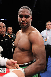 June 16, 2012; Newark, NJ, USA; Eddie Chambers looks at his injured left arm after his 12 round IBF North American Heavyweight title bout against Tomasz Adamek.