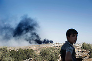 Syria. Smoke rise from a pampers factory shelled by regime army in Dar Ta' Zah area.  ALESSIO ROMENZI
