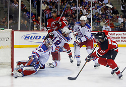 March 19, 2008; Newark, NJ, USA;  New Jersey Devils center Sergei Brylin (18) shoots the puck just wide of New York Rangers goalie Henrik Lundqvist (30) during the second period at the Prudential Center.