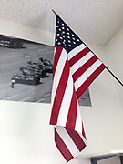 American flag haning in front of poster of Tiananmen Square in a classroom at Bigfork Middle School