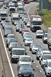 &copy; Licensed to London News Pictures. 21/07/2017<br /> M25 Anti Clock-wise traffic CHAOS towards the Dartford crossing from Kent into Essex. Traffic is at a near standstill as the summer holiday getaway madness begins as the schools break up for the summer.<br /> Photo credit: Grant Falvey/LNP