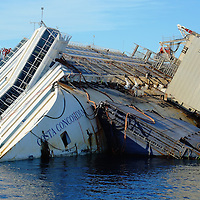 ISOLA DEL GIGLIO, ITALY - SEPTEMBER 13:  The wreckage of the Costa Concordia is seen on September 13, 2013 in Isola del Giglio, Italy. An attempt to raise the Costa Concordia is due to start on Monday 16th September.  (Photo by Marco Secchi/Getty Images)