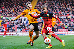 v26 is tackled by Wolves Forward Kevin Doyle (IRL) during the first half of the match - Photo mandatory by-line: Rogan Thomson/JMP - Tel: Mobile: 07966 386802 01/12/2012 - SPORT - FOOTBALL - Ashton Gate - Bristol. Bristol City v Wolverhampton Wanderers - npower Championship.