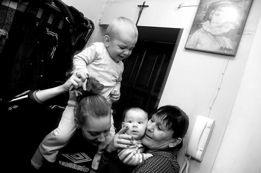 17/3/2011.Targówek, Warszawa, Poland. M. T., 27, together with her 2 sons (3 years old, and 6 months old) found shelter at her mother's house in Targowek (Warsaw). She escaped from her violent alcoholic husband that beat her and burnt cigarettes on her hands in front of the children.The flat of the mother (H. T.) is only 18 m2 and here lives also Mr G., unemployed, sick, who weights about 200 Kg. There is no toilette or bathroom in the flat and M. sleeps on a mattress in the kitchen with her 2 sons.