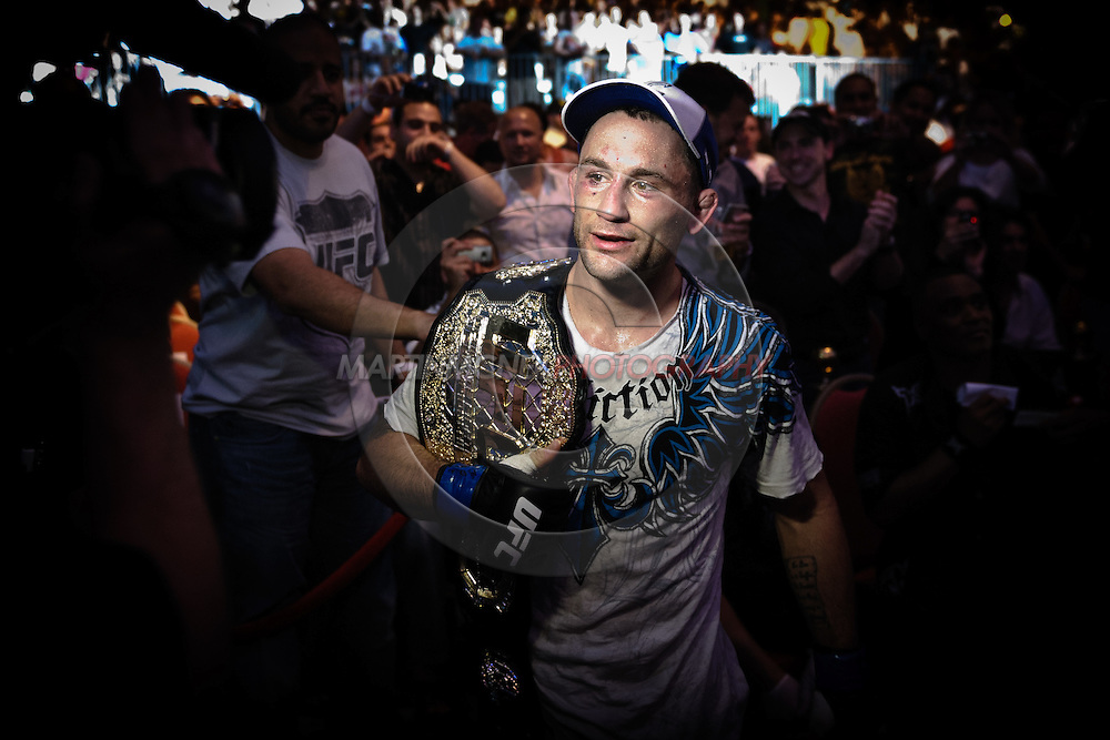 "ABU DHABI, UNITED ARAB EMIRATES, APRIL 10, 2010: Frankie Edgar exits the arena with the UFC lightweight championship belt at ""UFC 112: Invincible"" inside Ferari World, Abu Dhabi on April 10, 2010"