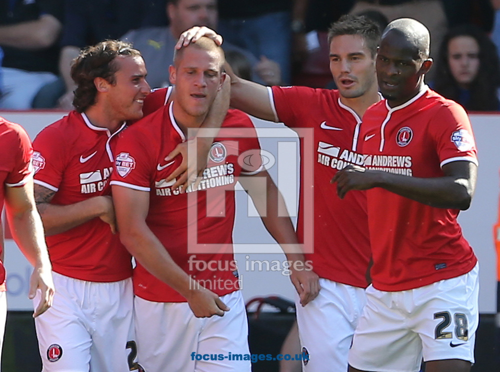 Picture by Richard Calver/Focus Images Ltd +447792 981244<br /> 31/08/2013<br /> Michael Morrison of Charlton Athletic is congratulated by team mates after scoring the opening goal during the Sky Bet Championship match against Leicester City at The Valley, London.