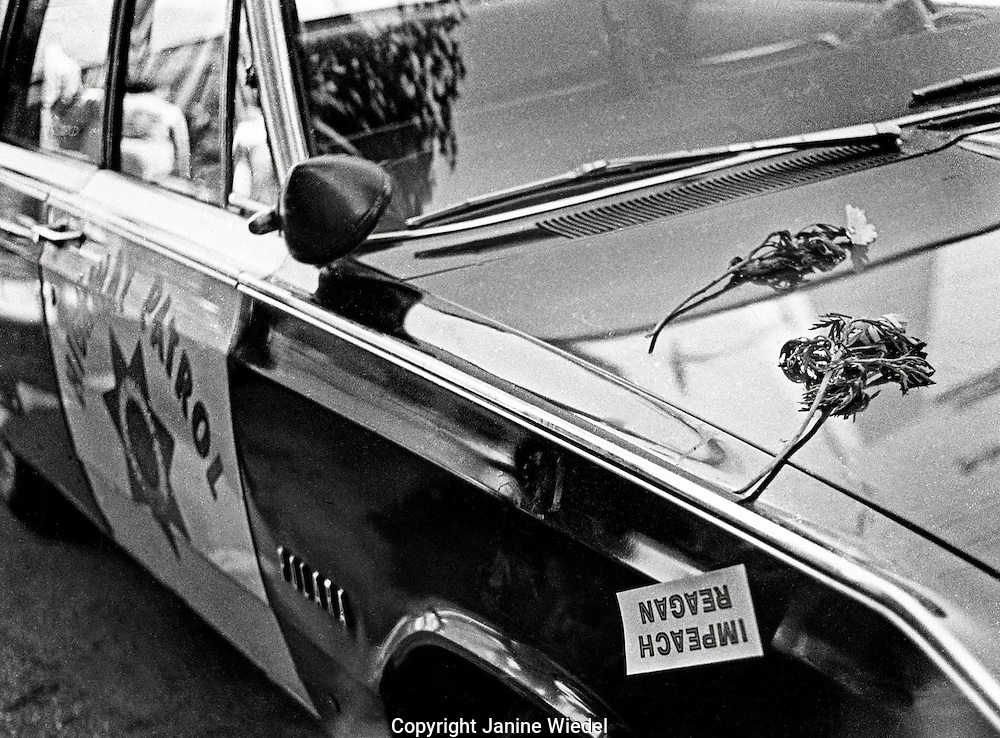 Impeach Reagon sign on police car during Peoples Park  Student protest & riots in Berkeley California 1969