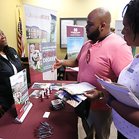 Pierre and Kenya Pope, of Belden, talk with Valerie Tate, Coordinator at the Center for Distance Education at Mississippi State University, about continuing his education for a Masters Degree in Teaching and Counseling during the Mississippi State Universuty Education Fair Monday afternoon at the Hancock Leadership Center in Tupelo.