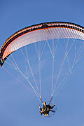 Paramotor pilot flies over St Georges Cay, Eleuthera, The Bahamas