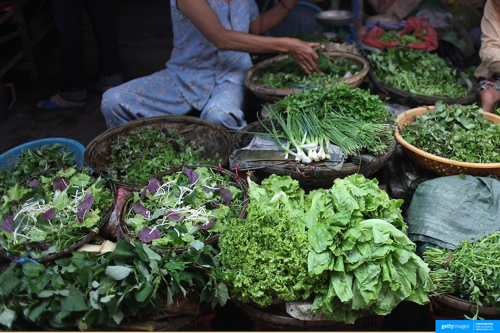 Fresh greens for sale at the market in Hoi An, Vietnam. Hoi An is an ancient town and an exceptionally well-preserved example of a South-East Asian trading port dating from the 15th century. Hoi An is now a major tourist attraction because of its history. Hoi An, Vietnam. 5th March 2012. Photo Tim Clayton